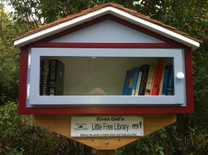 "Riven Dell's Little Free Library is located on Riven Dell Road about halfway between Rivendell Court and Tolkien. According to one of the project organizers, Ken Oisi, the original books have been taken, replaced by a range of self-help, novels, nonfiction, Oprah Winfrey picks and The Life of Pi. ""That one was gone immediately,"" Oisi explains."