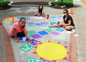 Youth Action Council crew are excited to unveil their custom made hopscotch game at George Rogers Park's playground Grand Opening this Saturday.