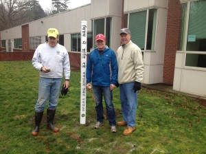 """Lake Oswego Rotarians recently planted Peace Poles at the six elementary schools in town. This one, at Oak Creek, says """"May Peace Prevail on Earth"""" in English, Spanish, Korean, Arabic, Chinese, Farsi, Russian and Hindi."""